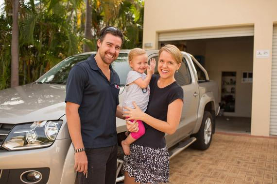 Happy family with car
